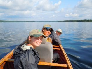 Interns paddling on the lake